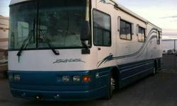 Original Owner, No Smoking, No Pets, All Service Is Up to Date on this Beautiful Coach.  INTERIOR FEATURES: Ceramic Floors, Walnut Cabinets, Corian Counter Tops, Full Kitchen, Wood Grained Top/Bottom Fridge, Conv. Microwave, Stove Top, Split