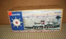 2001 Texaco Millenium Edition Texaco Tugboat Bank. 2nd in the series. In original condition and packaging. Sacrifice at $20. Others available... And Hess Trucks. Call Linda at --.