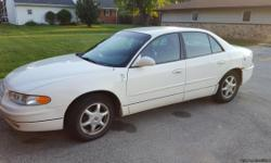 White with grey leather interior. Comfortable, reliable car. No accidents. A few small things in trunk and rear fender,otherwise interior in excellent condition. Power Windows, locks, seats, etc. 60,000 mile newer tires. 131,000 mi. Owned since 2002.