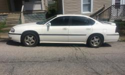 All white Impala. I'm not sure whats wrong with it but it's for sell and can be use for parts.