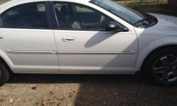 A 2002 WHITE  DODGE STRATUS  2.7 ENGINE SELLING FOR 1000.00 AS IS BECAUSE I DONT KNOW WHAT THE MECHANIC DID TO IT WAS RUNNING PERFECT NEW TIRES,NEW STRUTS NEW SEPERTINE BELT A/C AND HEAT JUST DON'T KNOW WHAT HE DID TO IT, AND I DONT