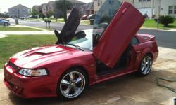 2002 Ford Mustang GT for sale. 4.6L engine, Super Charger, high performance exhaust system, 5 speed standard, Foose Nitrous 5 rims, many custom parts with only 65,000 miles. This vehicle was used as a show car for many years, runs great and you have to