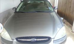 2002 FORD TAURUS (green) $1,800.00 Clean title, purchased four new tires on 3/8/14 from Discount Tire, alignment done, new starter, new battery,V-6, 3.0 engine, automatic transmission, power doors and windows, tinted windows, a.m, f.m radio, very