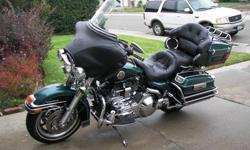 This 2002 Harley Davidson Ultra Classic Electra Glide - FLHTCUI has only 31,500 miles and is in great condition. It is green-blue with black trim and upholstery and is fully loaded. Features - Air Cooled; Anti-theft system; AM/FM/Cassette; CB Radio;