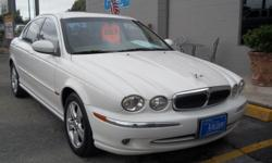 2002 JAGUAR X-TYPE 3.0 L V6 ENGINE , WHITE WITH CREAM LEATHER INTERIOR , 76,018 MILES , NAVIGATION SYSTEM, PLEASE CALL FOR APPOINTMENT! ASK FOR MIKE OR STEVE. MORE CLEAN INVENTORY AVILABLE! FINANCING AVILABLE!