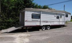2002 K-Z 29P Toy Hauler : Used sparingly by one owner. NEVER TAKEN ON ROAD; garage used for seasonal storage; living area slept in ~ dozen times; fridge, freezer, oven used once; range, microwave, bathroom never used. Sleeps 4: queen bed + fold down