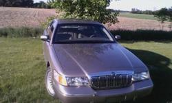 Hi I have a clean 2002 Mercury Grand Marquis, Gold, LS, With 58,442 Miles! Cool Cloth Tan Int, No Hot Lather.. Both Front Seats are Power, With Lumbar! Cold A/C! Key less Entry, 2 Keys & 2 Remotes, Dual Air Bags, Heated Mirrors, A/M, F/M C/D, Runs &
