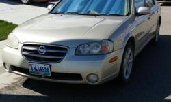FOR SALE: This 2002 Nissan Maxima 4-door sedan with spoiler, sport wheels is in great condition!. This vehicle would be great for college or a first time car owner. It gets 32 to 35 miles per gallon for gas mileage, is great on the highway or