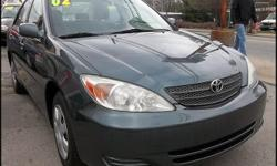 2002 Toyota Camry LE | WWW.CARLOSAUTOSALES.NET | Exterior / interior color: Aspen Green Pearl / Light Stone | Engine: 2.4L L4 FI DOHC 16V | Transmission: Automatic w/ overdrive | Mileage: 163,122 | Title: Clean | EPA MPG: 24 City / 34 Hwy | Options: Power