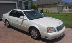 SELLER COMMENTS This car is enjoyable to drive, very powerful engine. It has two keyless remotes with keys to each. Exterior is a white pearl with an all gray interior leather. It has a 4.6cu/ft 32 valve Northstar V8 engine with 18 mpg city & 27 mpg