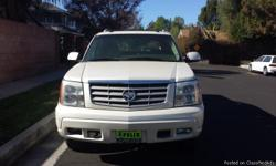 2003 Cadillac Escalade great condition. Minor damage to the to the driver side mirror and two small dents for the back bumper and small scratches as well. Mileage on it is only 104971.  CAR FEATURES: -back up sensors -track control -moonroof