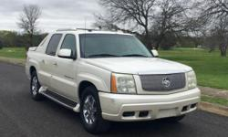 Mileage:86,100 Miles Exterior:Pearl Interior:Silver Engine:6.0L V8 Natural Aspiration Transmission:Automatic 4-Speed Fuel Type:Gasoline Trim/Package:Base AWD 4dr Crew Cab SB MPG City/Hwy:11 city / 15 hwy   Factory Chrome wheels, Leather, Sun roof,