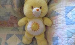 *~*This is a Sweet Sunshine Bear care bear. She needs a light Washing, her one eye has some light scratches on it.. The heart has a tiny bit of wear to lettering but not bad at all .Very Sweet Bear from a smoke fre home *~*  YOU CAN CALL OR EMAIL