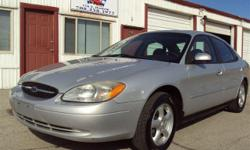 2003 Ford Taurus. It is an SES model. They are fully loaded with a power sunroof. Rear spoiler. Power windows, locks, and seats. Remote entry. C/D player. Brand new tires on Ford factory mag wheels. The car has 101k. For miles. This thing runs really