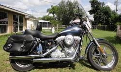 This 100th anniversary edition Superglide has a tone of chrome upgrades, a detachable windsheild, Harley Davidson leather saddle bags, Harley Davidson seat with back rest, custom Harley Davidson chrome wheels and a very loud custom horn. This bike