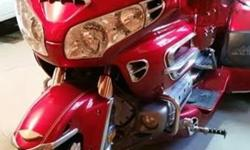 Get ready to tackle your next adventure with this 2003 Honda GL1800 Goldwing Trike! This motorcycle is powered by an 1,832 cc fuel-injected engine that is mated with 5-speed shaft drive transmission, this handsome red devil is well equipped to make