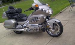 Take a vacation this summer, and Ride this machine ANYWHERE!!!    The color is beige, but looks more like Titanium.  The paint is near perfect, and the chrome shines to a blinding finish.  All the bells and whistles-