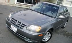 2003 Hyundai Accent GL 4-Door Sedan Fuel: Gasoline Engine: I4 1.6L DOHC Mileage: Only 138,125! Stock Number: 493146 Drivetrain: Front Wheel Drive VIN: KMHCG45C83U493146 Title: Clear Transmission: Automatic Exterior Color: Silver Interior Color: Gray