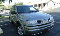 Ihave a 2003 olds bravada fully loaded with power windows,brakes,stering,locks,sliding moonroof,seats,heated seats that heat up fast,memory seats,new tires,lower driving lights,keyless entry,fresh oil change,ice cold a/c hot heater,gold in color