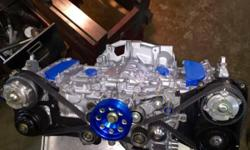 Subaru STI/EJ257 -EJ255 Stock rebuilt Long Block Comes with: -New OEM PISTONS -New OEM RINGS -New Bearings (King Bearings or ACL -Can upgrade to race bearings add $100 for rods and mains) -New Water pump -New Genuine Subaru OEM Head Gaskets :(Tomei, JE