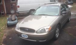 This 2004 ford Tarus ses sedan in tan has Biege leather interior with a v6 and a automatic with air power windows and locks tilt and cruise a cd and power moonroof with aluminum wheels. This car is very very clean and has a clean carfax with only 64,000