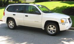 Excellent Condition. White, 4 door, GMC ENVOY SUV, sunroof, AM/FM Stereo, CD, Electric windows, keyless down entry, Gray interior. Mileage 59,000.
