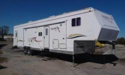 sleeps 4 to 6 people everything works great. has ac and heater that is ducted throughout whole RV. has 4000 watt Onan generator also has fuel station. all of the appliances work great. the toy haul box size is 12 feet long by 8 feet wide the weight of the