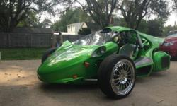 """2005 Campagna T-Rex Kawasaki 12R Motor  This T-Rex is in amazing conditional and mechanical sound no issues at all.  Custom Tri Coat Candy Apple Green Paint Inside and out Custom Seat covers With Stitching 7"""" kenwood TV in dash 2 6"""