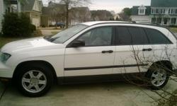 2005 Chrysler Pacifica White with Tan Leather Interior in excellent condition; 137,040 Miles; Six Cylinder 3.5 L Engine; Power Everything; Heated Power Seats, Automatic, Luggage Rack, Tinted Rear Windows; DVD Player and CD Player (No