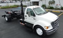 """Stock #25815 **54"""" Hook Height** **20,000 lb Hook Lift Hoist** **Single Axle** 100 % Work Ready, Certified Pre-Owned 210 Point Inspection, Federal DOT Inspection, 2 Year / 200K Mile Warranty For Up To Date Inventory Information or More Details on This"""