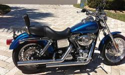 2005 Harley Davidson FXDL Low Rider , Less than 3000 miles, Always garage kept, Rare rich sun glo blue paint, Spoke wheels, Vance & Hines pipes, Stage 1 kit, Badlander seat with sissy bar, Luggage rack, Original paperwork, Lots of extras, Looks like new