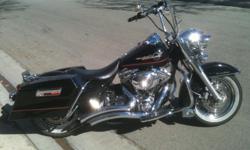 All black road king with red pin stripe on tank. 32,000 miles.