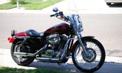 FUN RIDE for sale. Lava Red Sunglow factory paint. Like NEW condition, very well maintained. 3,676 miles - mostly garaged the last two years. Front crash bars, Screaming Eagle package, detachable windshield and rear fender chrome carrier/saddlebag rack,