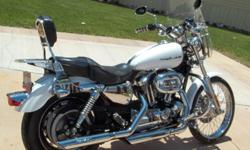 harley sportster lots of chrome runs great good tires we are just wanting to upgrade. the color is white must see.