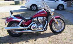 The motorcycle is in excellent condition and has about 5,075 miles on it. It is red, has a windshield and back rest. Feel free to give me a call with any questions. Will only except cash, Cashiers check or money order.