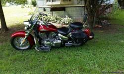 Vence Hines pipes, new back tire,new saddle bags, floor boards,garage kept no dents are scratches. 13,784 miles. Very nice bike must see.