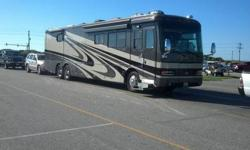 We are having to sell our Dynasty. This is a 42' tag axel, 4 slide motor home. It has new Michelin's all the way round and new house batteries. It also has a desk, queen bed,Mirrored Wardrobe Stove Top,Convection Microwave,Residental Westinghouse Side by