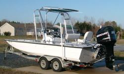 excellent condition, low hours, t-top, rod holders, tandem trailer, 225 mrec optimax with powerlift, 2-12v powerpoints, sony stereo system, gps/fishfinder, compass, full uscg package, extras