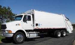 32 YARD LEACH REAR LOAD GARBAGE TRUCK, 90K MILES, AIR BRAKES, 12,000LB CONTAINER WINCH, ALUMINUM WHEELS, READY FOR WORK TODAY