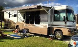 """2005 Winnebago Adventurer M-38J-workhorse Gas. 31,000 miles, 3 slide outs, central/ducted A/C Heater, washer/dryer combo, side by side refrigerator, 10 gallon water heater, 27"""" tv, hydraulic leveling system, 1000 watt inverter, rear vision camera/monitor,"""