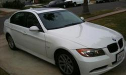 2006 BMW 325i with navigation w/ sport steering and luxury seating.beverage cooler,adjustable rear headest,cruise control, tire pressure monitor, etc.