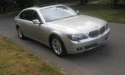 2006 BMW 750 Li, Automatic, Silver, Power Windows, Power Doors, Heated Seats, Leather Seats, Traction Control, Power Locks, Cruise Control, Power Steering, Navigation System, Parking Sensors, Dual Airbags, Multi-Cd Changer, Dual Power Seats, Sunroof, HID