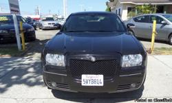 Red Motoring Re5079 . This Chrysler 300C is an excellent value for the money. Miles play a big role in purchasing a vehicle, and this mileage reads low at 82,004. For you non-smokers out there, the ash tray is whistle clean because it has been smoke free