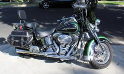 2006 Heritage Softail ? FLSTCI (fuel injected) $10,500 88 CI, 5-speed, ~25,322 miles Original owner ? Always garage kept ? Never crashed Dragonfly Green with Ghost Flames on front fender and gas tank. This is a factory color used by HD for 4-months.