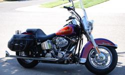 SMOOTH RIDE for sale. RARE Purple & Orange special edition factory paint. Like NEW condition - very well maintained. 2,705 miles - mostly garaged the last two years. Unique Sampson 2 into 2 fish tail pipes, detachable passenger backrest, soft detachable