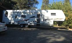 AWESOME TOYHAULER FOR SALE. HAS SEPARATE GARAGE WITH 2 ELECTRIC QUEEN BEDS MAIN SPACE HAS BDRM WITH QUEEN BED AND FOLD OUT COUCH AND TABLE BREAKS DOWN. 5000 GENERATOR FULL SURROUND SOUND STEREO/CD/DVD PLAYER, ON BOARD FUEL STATION, 2 SLIDE OUTS LG