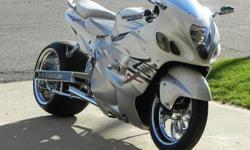 """Excellent condition..... VooDoo 4 into 2 Exhaust, Chrome Custom Wheels, Chrome Extended Swing Arm, Brand New Front and Rear Tire, Rear Tire is a 330, Indi-""""Glo"""" Guages with 3 settings, Power Commander, Chrome Windshield, Chrome Hand Grips, Chrome Cluster"""