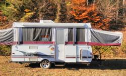 $18,000 when new. Expands out for more room. Fully loaded, double sink, fridge, microwave, toilet, shower, dining table with benches which converts to a sleeping area, beds in front and back of camper, two full propane tanks and outdoor grill, large