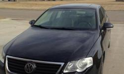 Low mileage clean black sedan. 4 door, automatic window, locks, sunroof.  2.0T, front wheel drive. Has hail damage. 70,000 miles
