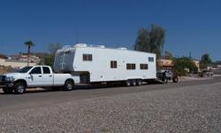 "2006 Weekend Warrior 5th Wheel M-3505 LE 36 x 8'5"" Self Contained - 18 ft. load space Awning - Fiberglass Exterior Air Conditioning and heating Fule Station - Outside Shower - Generator 15,000 BTU - Microwave - 10 gallon water heater - Electric Jacks No"